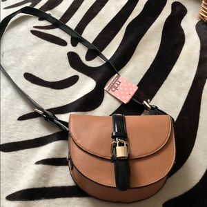 BNWT camel with black piping bag.  With lock.